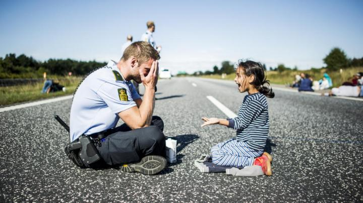 Danish Police and a Syrian girl, treated with DIGNITY