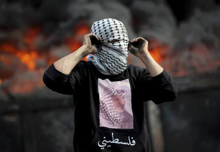 Keep your head up, you are a Palestinian, Do not bend, bow, no matter how necessary it may be, you may not have the chance to raise your head ever again,